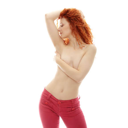 Beautiful young ginger topless woman  Isolated on white  photo
