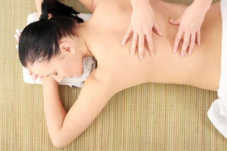 Beautiful young woman having massage photo