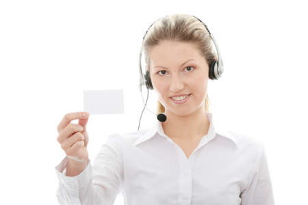 Call center woman with headset showing business card. Beautiful smiling caucasian woman isolated on white background.  photo