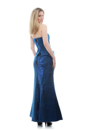 Young woman wearing a blue dress posing isolated on a white background photo