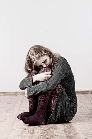 Sad or depressed woman sitting on the flor Stock Photo - 9023639