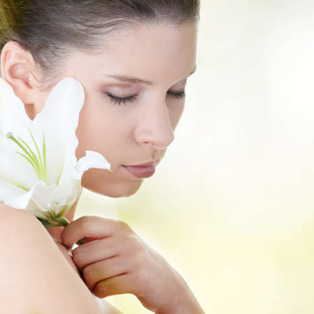 Portrait of fresh and beautiful woman with lily flower photo