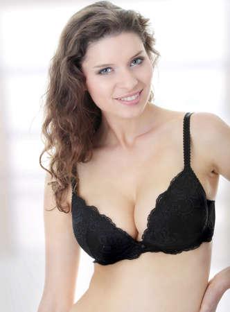 Portrait of beautiful woman wearing a black bra photo