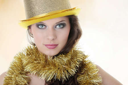 Young beautiful caucasian woman in party gold hat photo