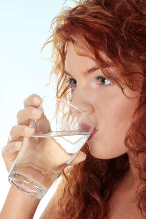 water hand: Young caucasian woman drinking water from glass