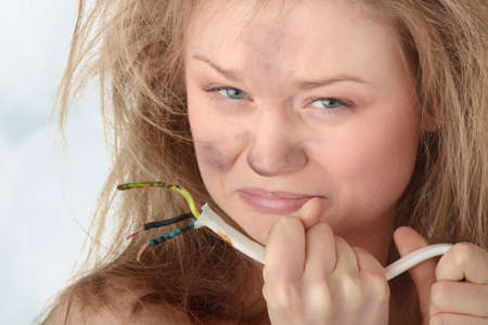Young woman with wire - electric shock photo