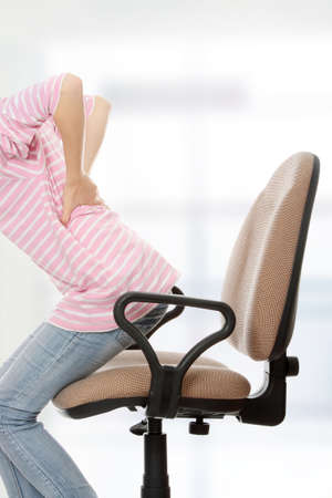 pained: Teen student woman with back pain Stock Photo