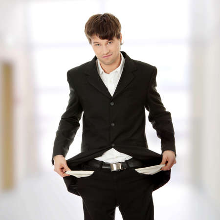 Sad and broke business man with empty pockets Stock Photo - 9021405