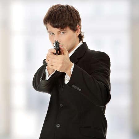 Businessman aiming with handgun photo
