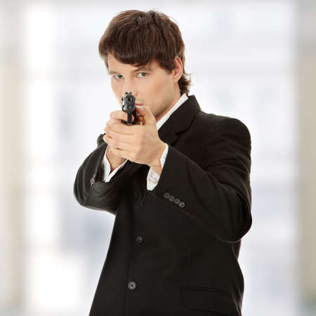 secret service: Businessman aiming with handgun