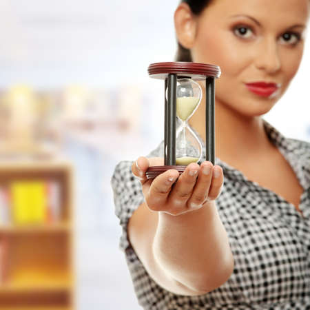 glasses in the sand: Young business woman with hourglass - time concept