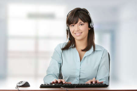 Young beautiful caucasian woman working in call center photo