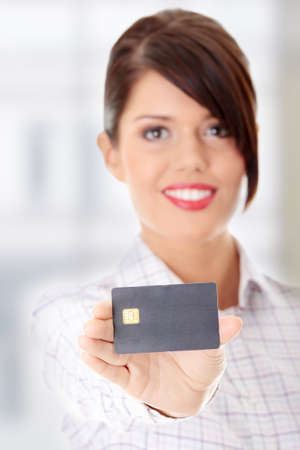 Woman with a credit card on her hand Stock Photo - 9013230