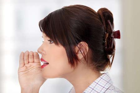 hesitations: Young businesswoman talking gossip