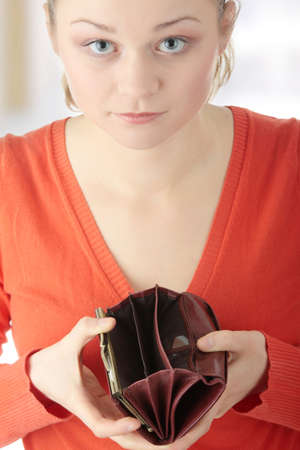 empty wallet: Young woman shows her empty wallet