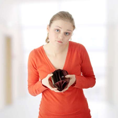 Young woman shows her empty wallet Stock Photo - 9023137