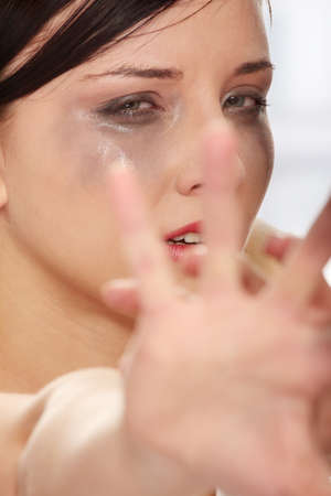Abused woman crying photo