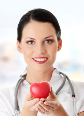 healthy person: Young doctor with heart in her hand