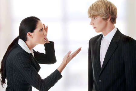 to argue: Work Colleagues arguing (woman shouting on man) Stock Photo