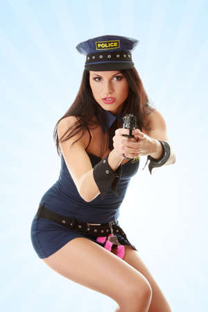 Beautiful sexy police girl with handgun and handcuffs Stock Photo - 9014949