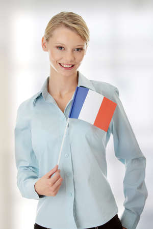 Young woman holding France flag photo