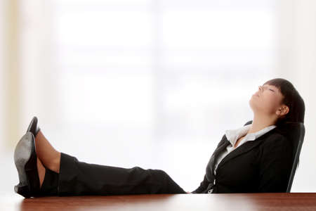 Young beautiful business lady having a rest at the working place. Stock Photo - 9003048