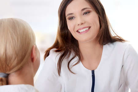 Young female doctor with female patient. Stock Photo - 9021239