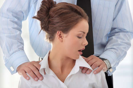sexual violence: Molestation at work concept. Man molestating woman