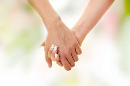 Two woman holding their hands photo