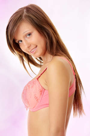 Teen girl in swimsuit over abstract pink  photo