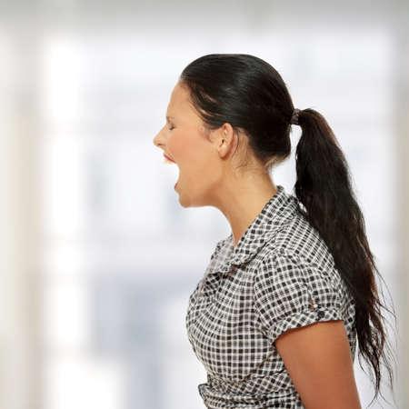 eyesclosed: Young business woman shouting