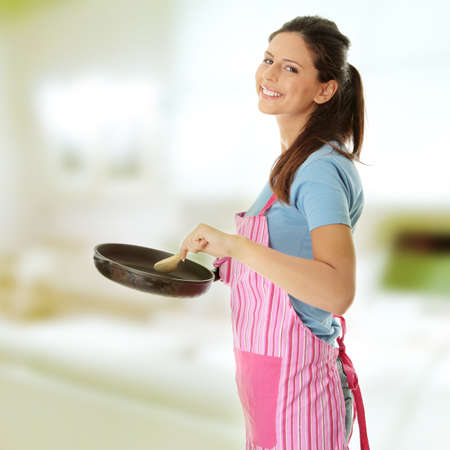 woman cooking: Young woman cooking healthy food