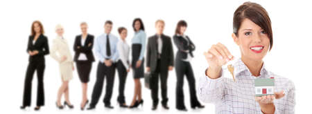 реальный: Young businesswoman  (real estate agent) with hose model and keys