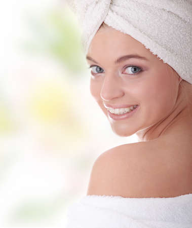 bathrobe: Portrait of young beautiful woman wearing bathrobe