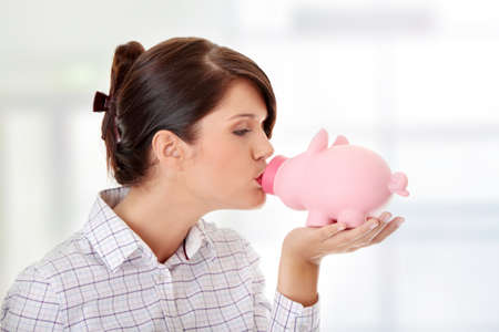 Woman Holding Piggy Bank  Stock Photo - 9028775