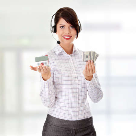 Young businesswoman in headset holding hose model and cash  photo