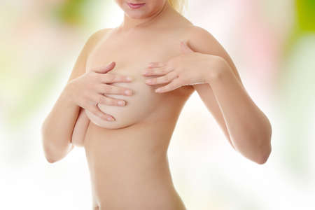 Breast cancer - Woman holding her breast  photo