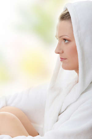 Young woman in bathrob isolated photo