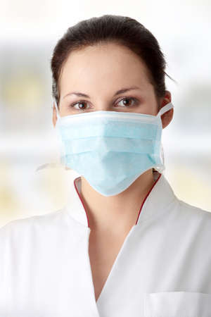 Young nurse in mask photo