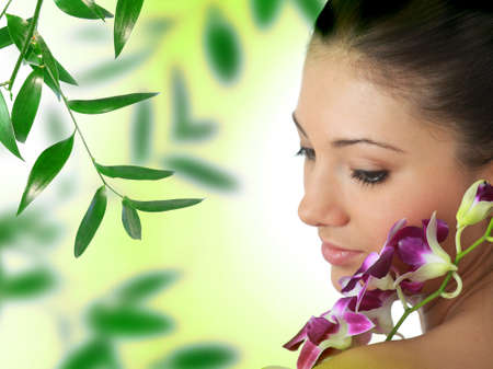 Beauteful spa girl with orchid Stock Photo - 9028761
