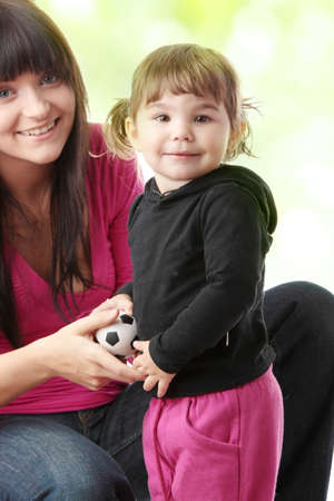 Portrait of a 2 year old girl with young mum photo