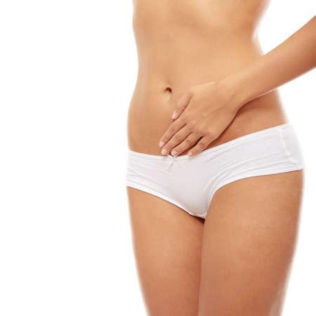 pancia grassa: Bel corpo femmina isolata on white. Donna giovane sexy in mutandine bianche  Archivio Fotografico