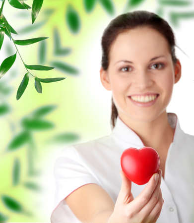 Young nurse with heart in her hand Stock Photo - 9028859