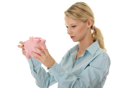 Young beautiful woman standing with piggy bank (money box), isolated on white background  photo