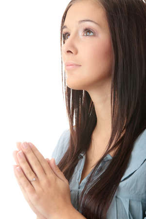 mujer orando: Closeup retrato de una joven cauc�sica orando aislada sobre fondo blanco