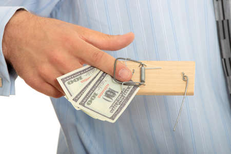Businessman with finger in moustrap - business trap concept photo