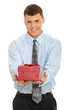gift parcel: Business man offering a gift over a white background