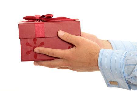 Business man offering a gift over a white background  photo
