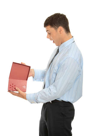 Business man opening a gift over a white background  photo