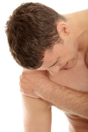 dolor hombro: Hombre joven con dolor de hombro